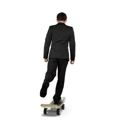Businessman playing on money skateboard isolated in white photo