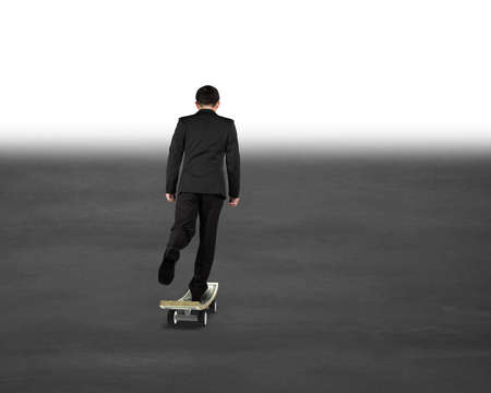 businessman skateboarding toward mist in front photo