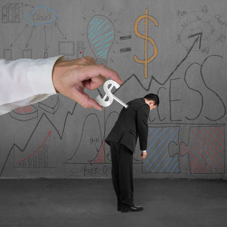 Winding money winder on man with business doodles on concrete wall background photo
