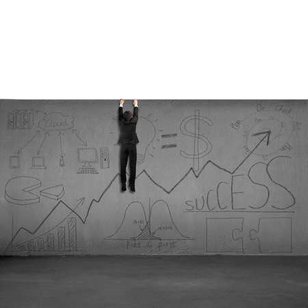 Man trying to climb over wall with business doodles isolated in white photo