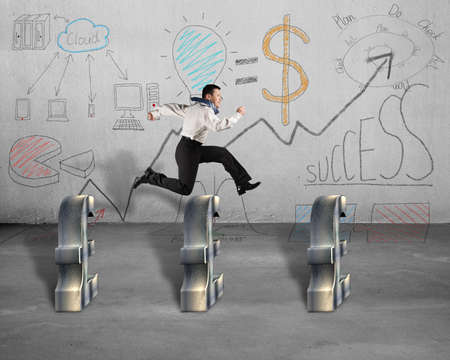 steeplechase: Jumping over pound symbol with business doodles on wall Stock Photo