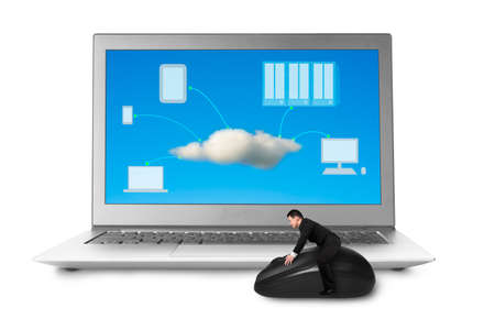 Man riding mouse with cloud computing picture on laptop screen photo