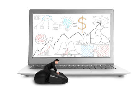 Businessman sitting on mouse with business doodles on laptop screen photo
