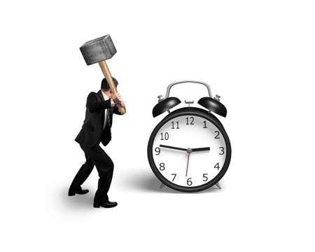 Man Using sledge hammer to damage alarm clock in white background Stock Photo