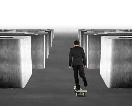 Businessman skateboarding money skateboard through maze photo