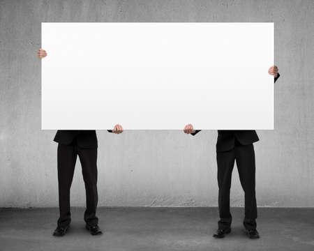 Men lifting blank board indoor photo