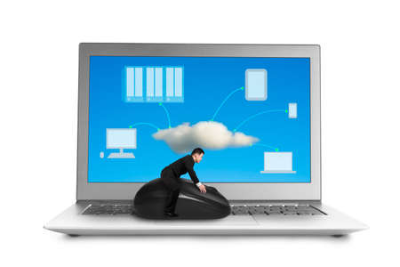 Businessman riding on mouse with cloud computing image on screen isolated in white  photo