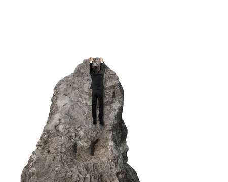 Man Trying to climb to top of rock mountain isolated in white photo