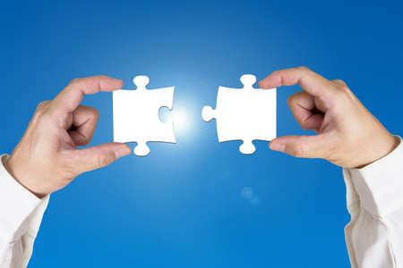 Assembling two blank puzzles together sunny sky  photo