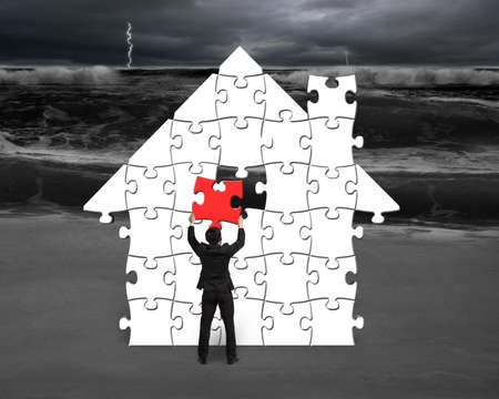 Put red puzzle into house shape for bad situation in front photo