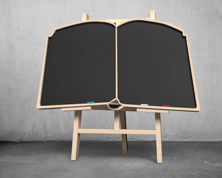 Blank blackboard in book shape on easel concrete background photo