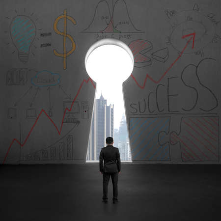 business opportunity: Standing and facing key shape hole with city view outside