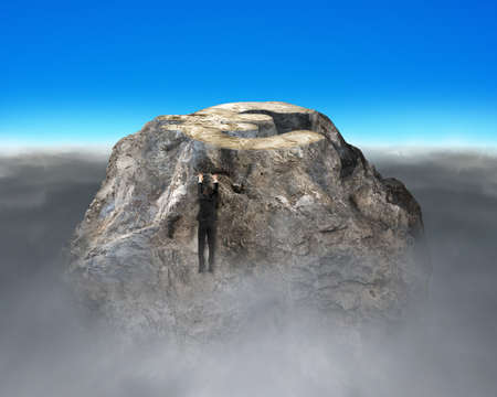 financial cliff: Man trying to climb up rocky money mountain with cloudy below Stock Photo
