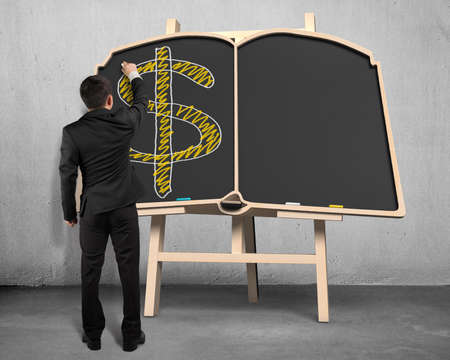 Businessman sketching money symbol on blackboard photo