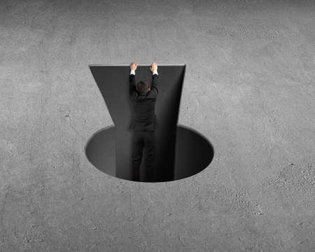 key hole: Man trying to climbing out from key shape hole