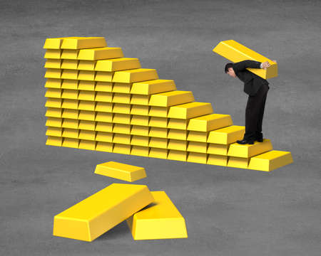 concrete stairs: Businessman carrying bullion on gold in stairs stacking on concrete ground Stock Photo
