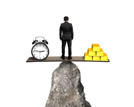 man standing between clock and gold balancing on rock seesaw isolated on white background photo