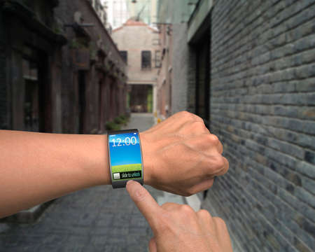 hand wear smart watch with finger touching in street