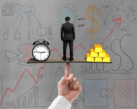 businessman between clock and gold balance on seesaw with business doodles background photo