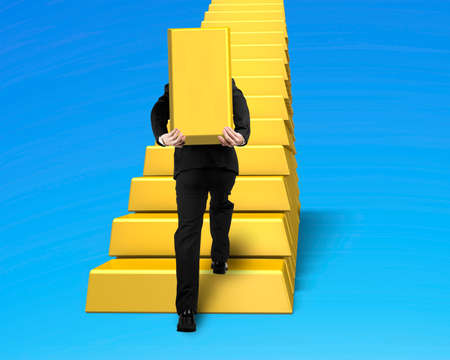 man carrying bullion and climbing gold stairs isolated on blue background photo