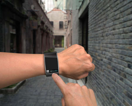 male hand wear iwatch with an index finger on street background Stock Photo