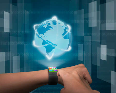 finger touching app on ultra-thin bent interface smartwatch to show out globe with glowing orbit on tech-digital background