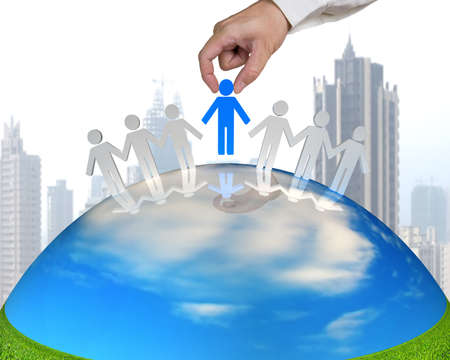 hand hold 3D people on nature globe with city background photo