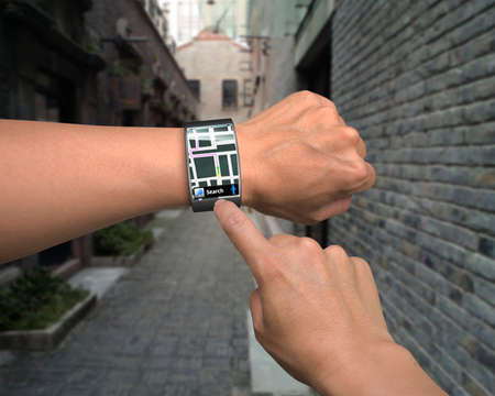 hand wear smartwatch with map guide on street background