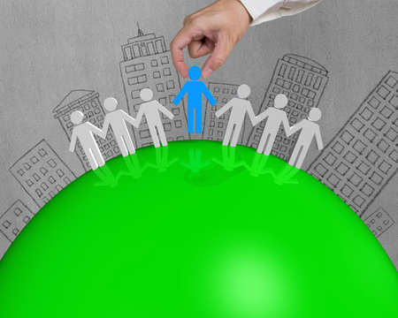 3D male connect on green globe with building doodles photo