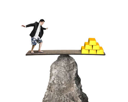 rocky: man standing on rocky seesaw vs stack of gold isolated on white background