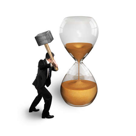 man holding hammer to hit hourglass isolated on white photo
