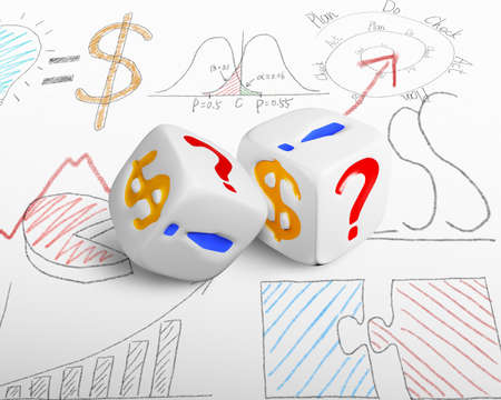two currency dices on doodles background photo