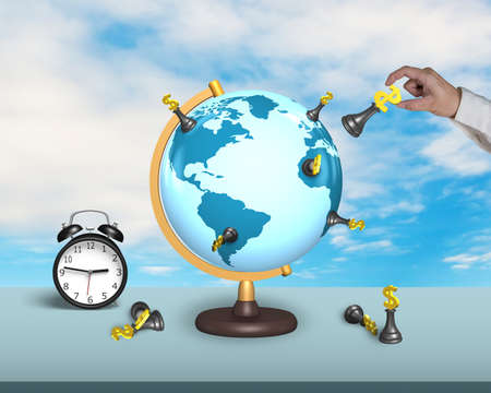 hand hold dollar chess on terrestrial globe with alarm clock and sky background photo