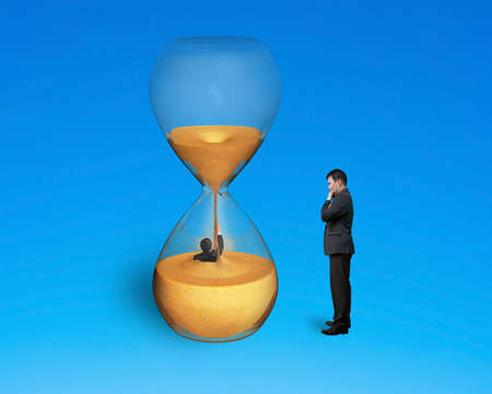 oversee: boss oversee employee flooded in hourglass isolated on blue