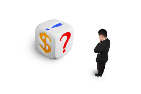 speculate: man watching white dice with dollar sign isolated on white Stock Photo