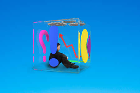 man sitting in glass cubic isolated on blue photo
