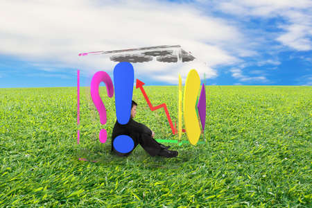 businessman sitting in glass cube on nature sky meadow background photo
