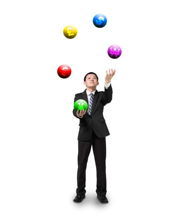 enables: black suit businessman juggling currency symbol balls isolated on white Stock Photo