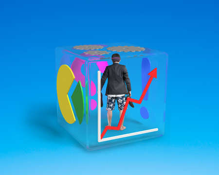 barefoot man with shorts standing in glass cube isolated on blue photo