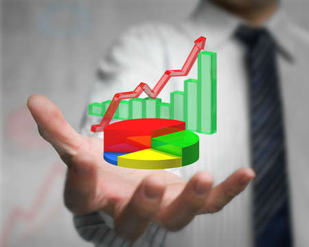 businessman hand holding 3d infographics overlapped, including colorful pie chart, green bar chart, red trend line photo