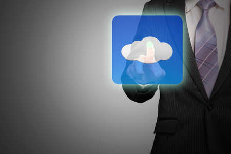 businessman hand touching cloud app icon on gray background photo