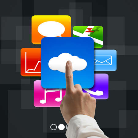 forefinger pointing at cloud computing with colorful app icons on tech background photo