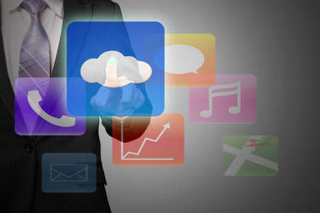 businessman hand pointing at cloud computing with colorful app icons on gray background photo