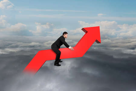 upward struggle: Businessman driving 3D red trend line in the sky with cumulus cloudscape background