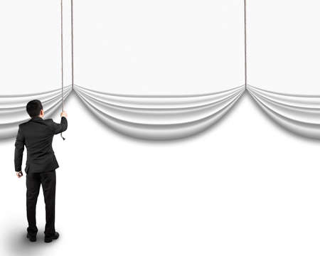 curtain: businessman pulling open blank curtain with empty behind isolated on white background