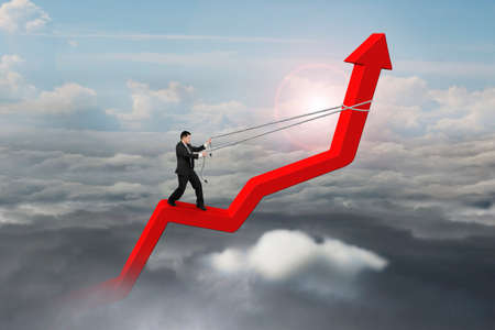 upward struggle: Businessman control arrow direction of 3D red trend line in the sky with cumulus cloudscapes background