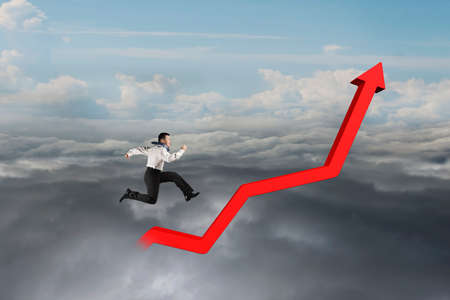 upward struggle: Businessman running on red growth trend line with cloudy sky background