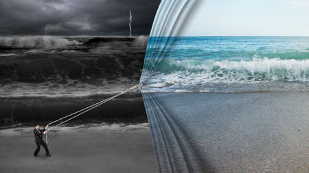 fearful: businessman pulling open calm sea curtain covered dark stormy ocean background