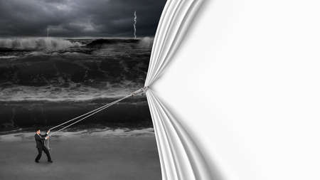 businessman pulling open blank curtain covered dark stormy ocean isolated on white background