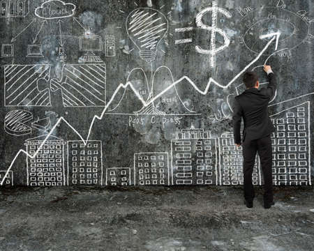 businessman drawing business concept doodles on old concrete wall and mottled floor background photo
